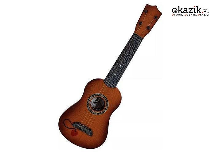 Gitara akustyczna dla najmłodszych muzyków. Gitara strunowa to idealny prezent dla małych dzieci lubiących muzykę.